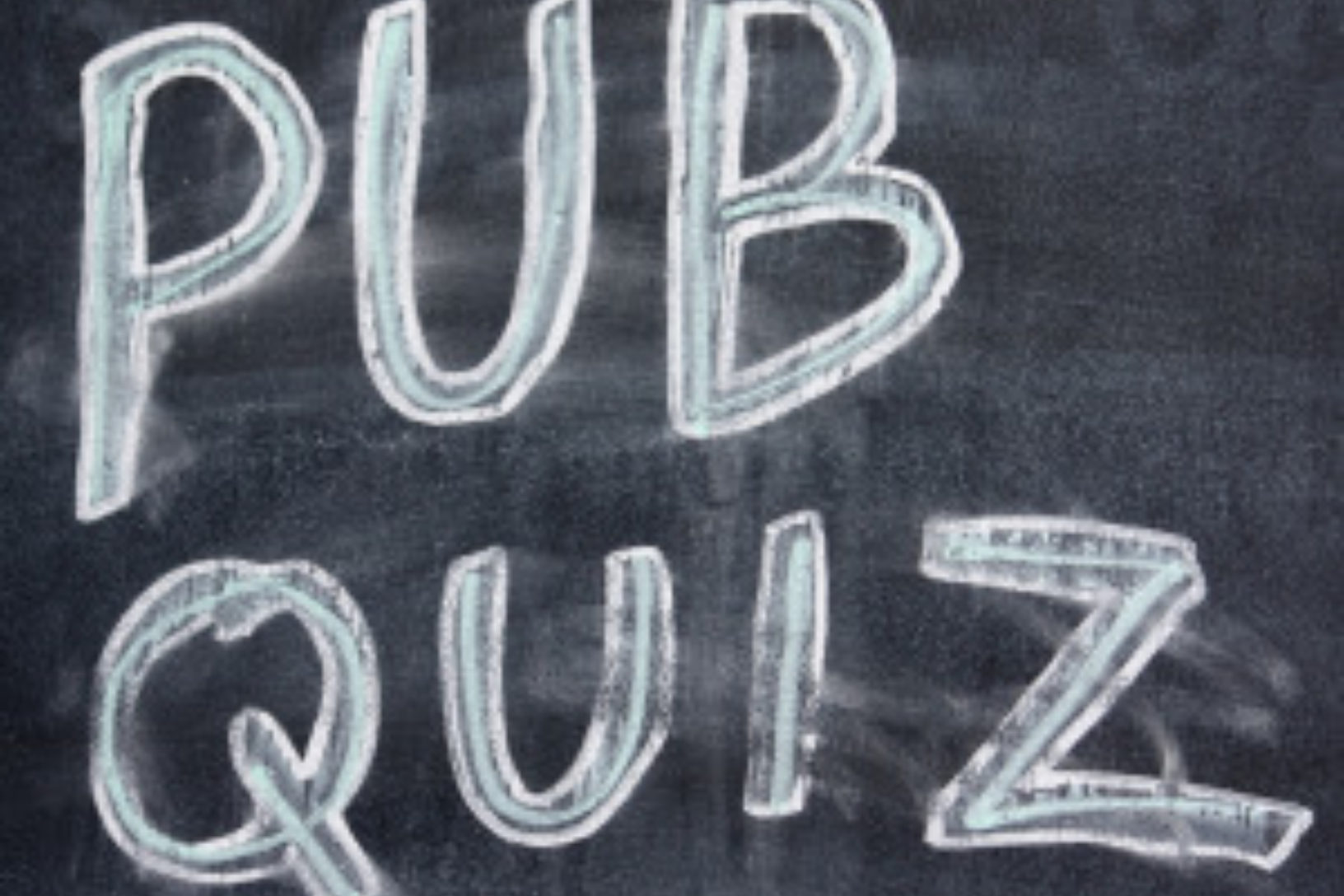 Pub quiz written on chalkboard