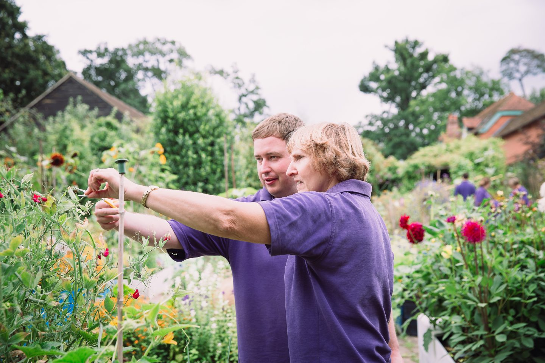 Chris L with vol looking at flower Charlie Garner 2019