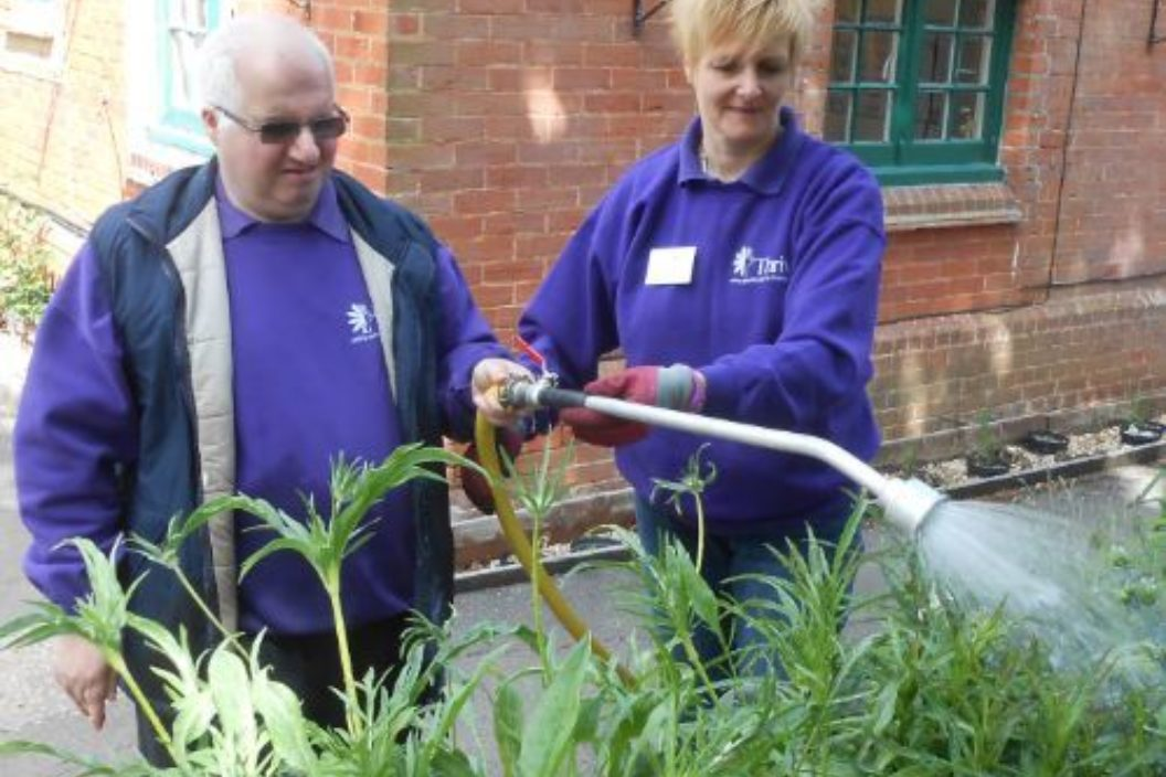 Paul and volunteer watering