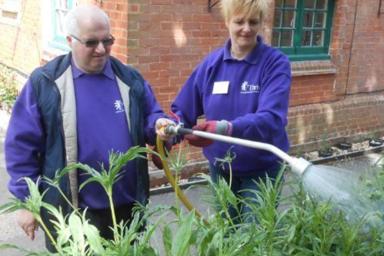 Paul and volunteer watering